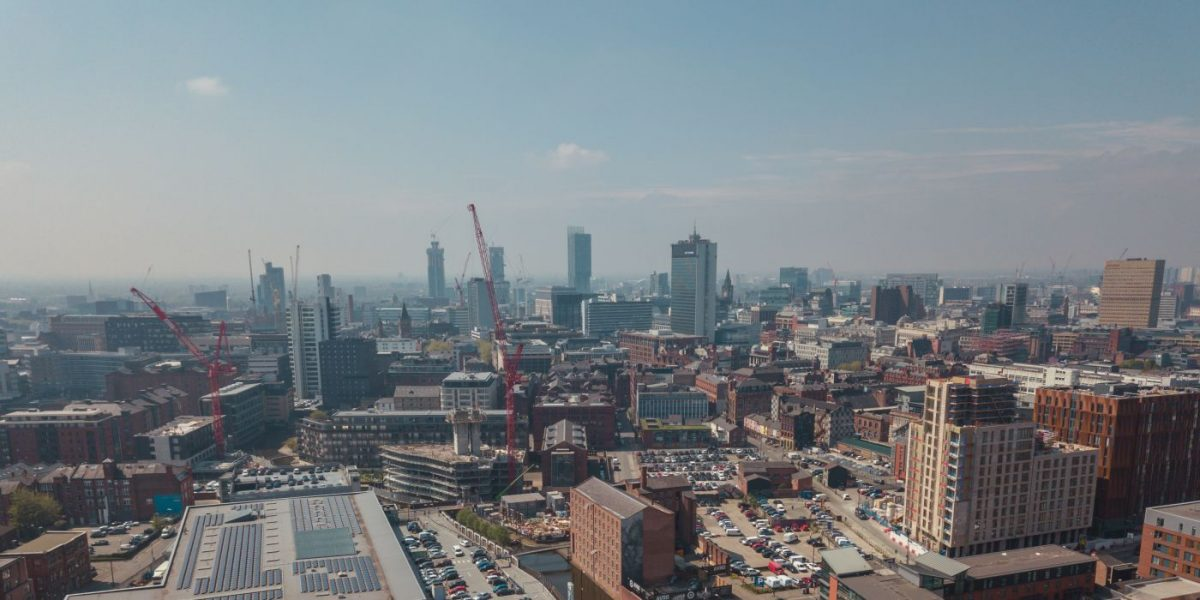 Aerial shot overlooking Manchester city centre with good view of skyline