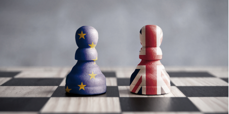 Two chess pieces, one in the colours of the UK union jack, and the other in the colours of the European Union flag. A representation of the Brexit process.