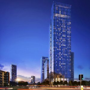 A night time render of Elizabeth Tower at Crown Street Manchester, with Victoria Residence behind the 52-storey skyscraper.
