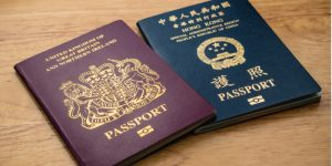 A British passport and a Hong Kong passport on a table next to each other