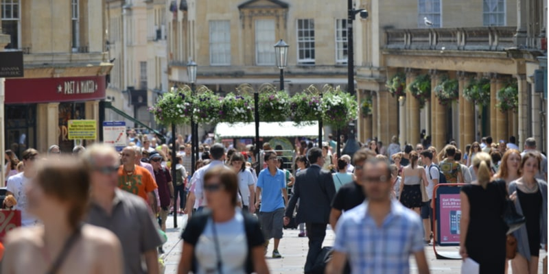 A busy shopping high street in the UK in the summer time