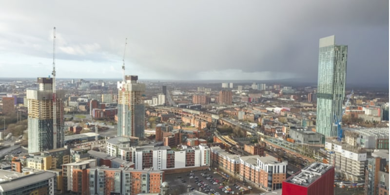 Aerial shot of Manchester city centre, with the Beetham Tower and two in-construction developments in the foreground.