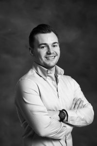 Black and white professional photo of Max Bielby, Managing Director of Vita Student