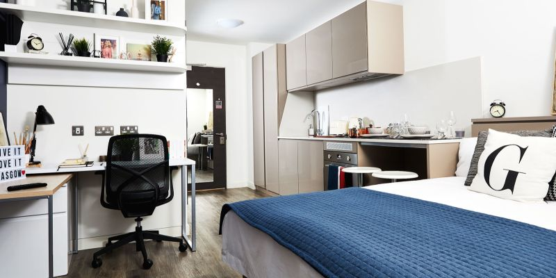 A mdoern PBSA apartment at Vita Student Glasgow, with an open plan kitchen and bedroom space
