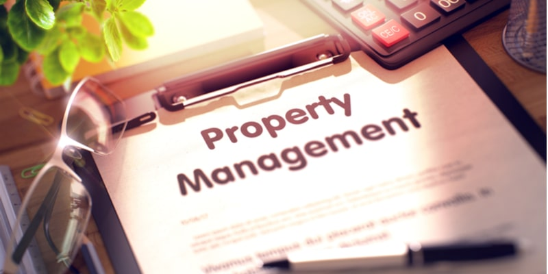 A clipboard with the title 'Property Management' on top of the sheet of paper
