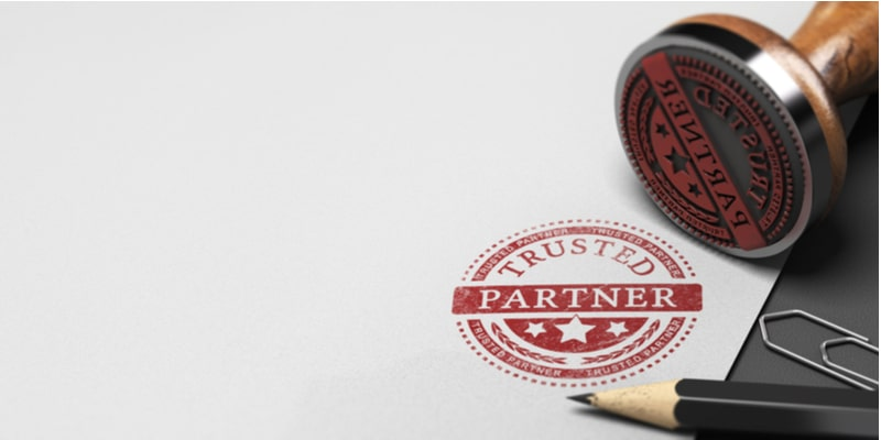 A red stamp on a white piece of paper, stating 'trusted partner'