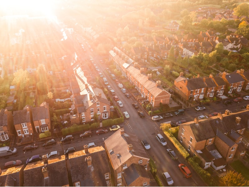 An aerial shot of a UK residential street at sunset